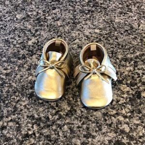 6-12 month worn twice gold moccasins